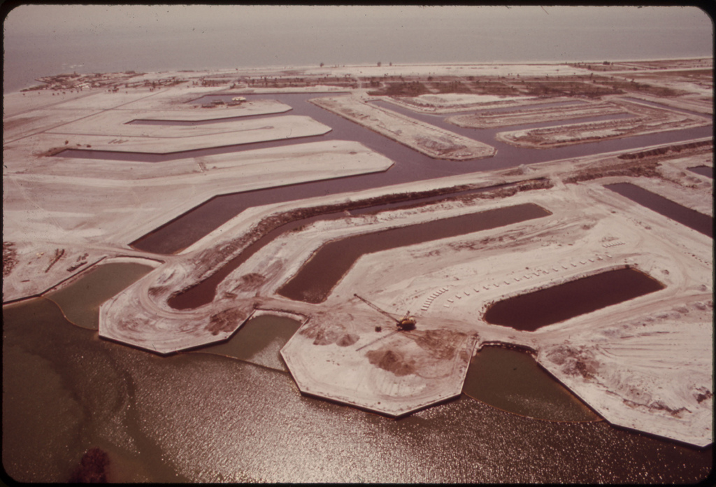"""Aerial View of the Marco Island Land Development, on the Southwestern Coast of Florida. Some of the Canals Seen Here Are Blocked From the Gulf of Mexico by Means of """"Land Plugs."""""""