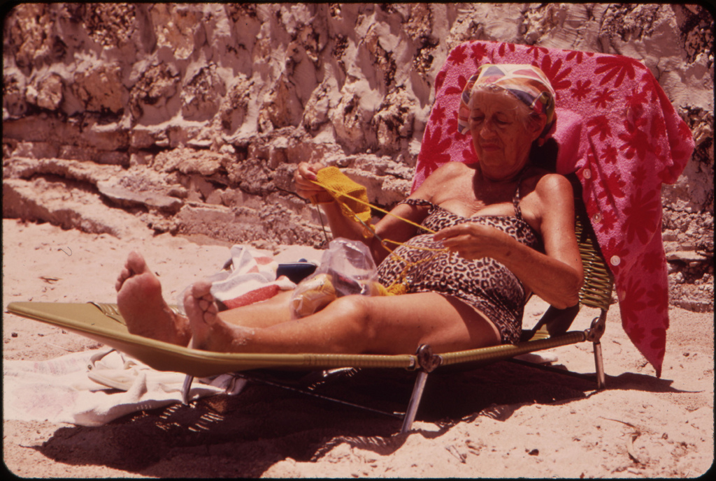 A Member of the South Beach Retirement Community Enjoys the Sun and Sea Air. Most of the Retirees in the Area Live in Inexpensive Residential Hotels Within Walking Distance of the Public Beach.