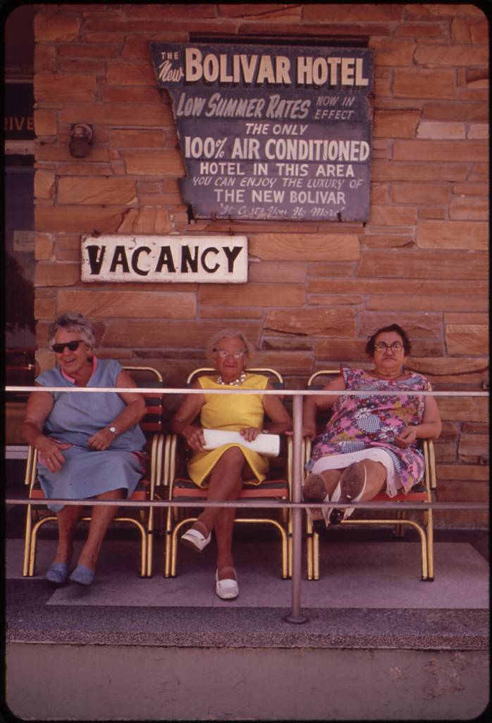 Inexpensive Retirement Hotels Are a Hallmark of the South Beach Area. A Favored Place Is the Front Porch, Where Residents Sit and Chat Or Watch the Activities on the Beach.