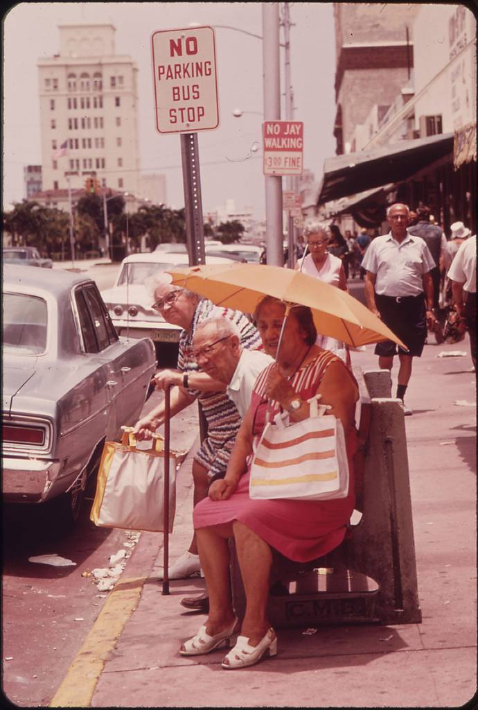 The South Beach Area of Miami Beach Has Attracted a Growing Colony of People of Retirement Age. This Group Waits for a Bus after a Shopping Trip.