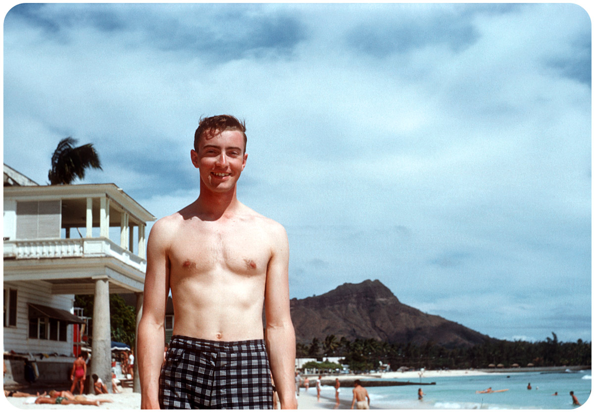 Layover in Waikiki — 1954 This Kodachrome moment captures a young serviceman on the way to Tsuiki Japan. In front of balcony next to Moana Hotel