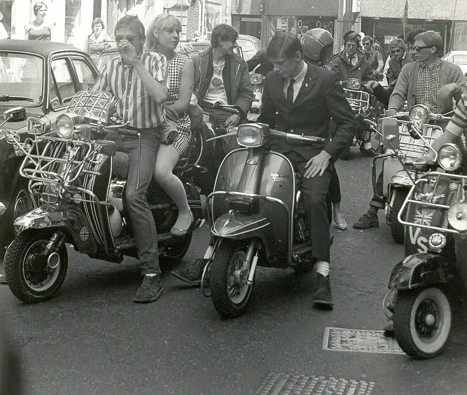 Mods on scooters in the Carnaby Street area of London filming 'Steppin' Out', summer 1979. 'Steppin' Out' is a short music documentary movie that was released in 1979. It was directed by Australian film director Lyndall Hobbs and was a survey of fashionable lifestyles in London which featured Secret Affair.