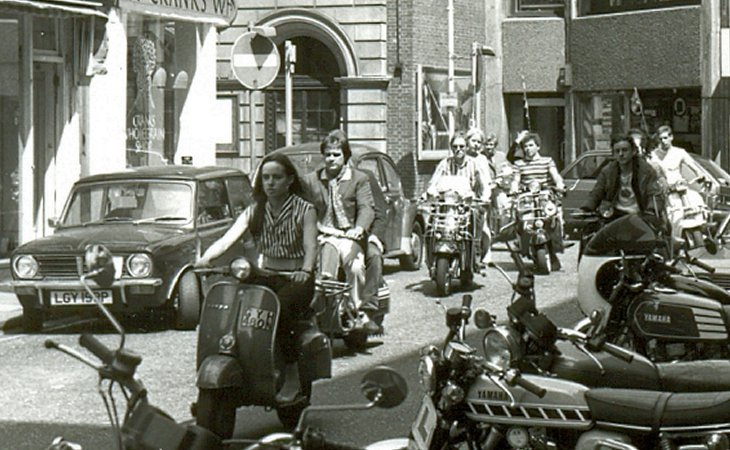 Mods on scooters in the Carnaby Street area of London being filmed for 'Steppin' Out', summer 1979.