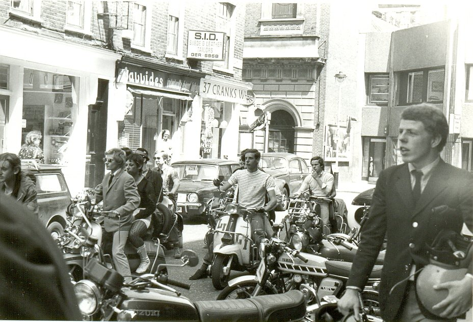 Mods, Mick Talbot of the Merton Parkas © photo by Paul Wright Mods on scooters in the Carnaby Street area of London being filmed for 'Steppin' Out', summer 1979. On the right of the photo is Mick Talbot of mod band The Merton Parkas.