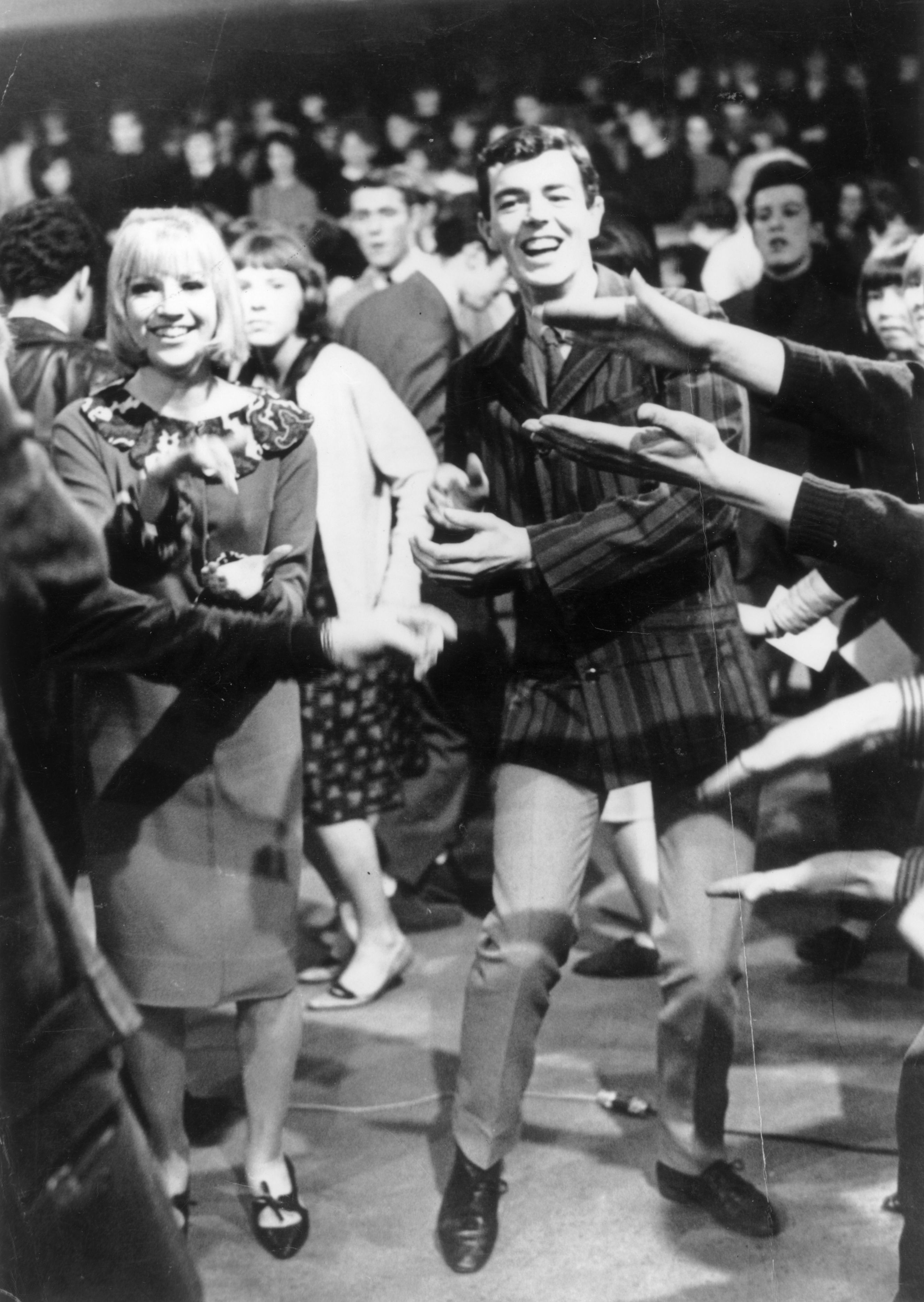 Resident dancers Patrick Kerr and his wife, Theresa Confrey, dancing during a recording of the British pop music TV programme 'Ready Steady Go!', London, February 1964. (Photo by Keystone Features/Getty Images)