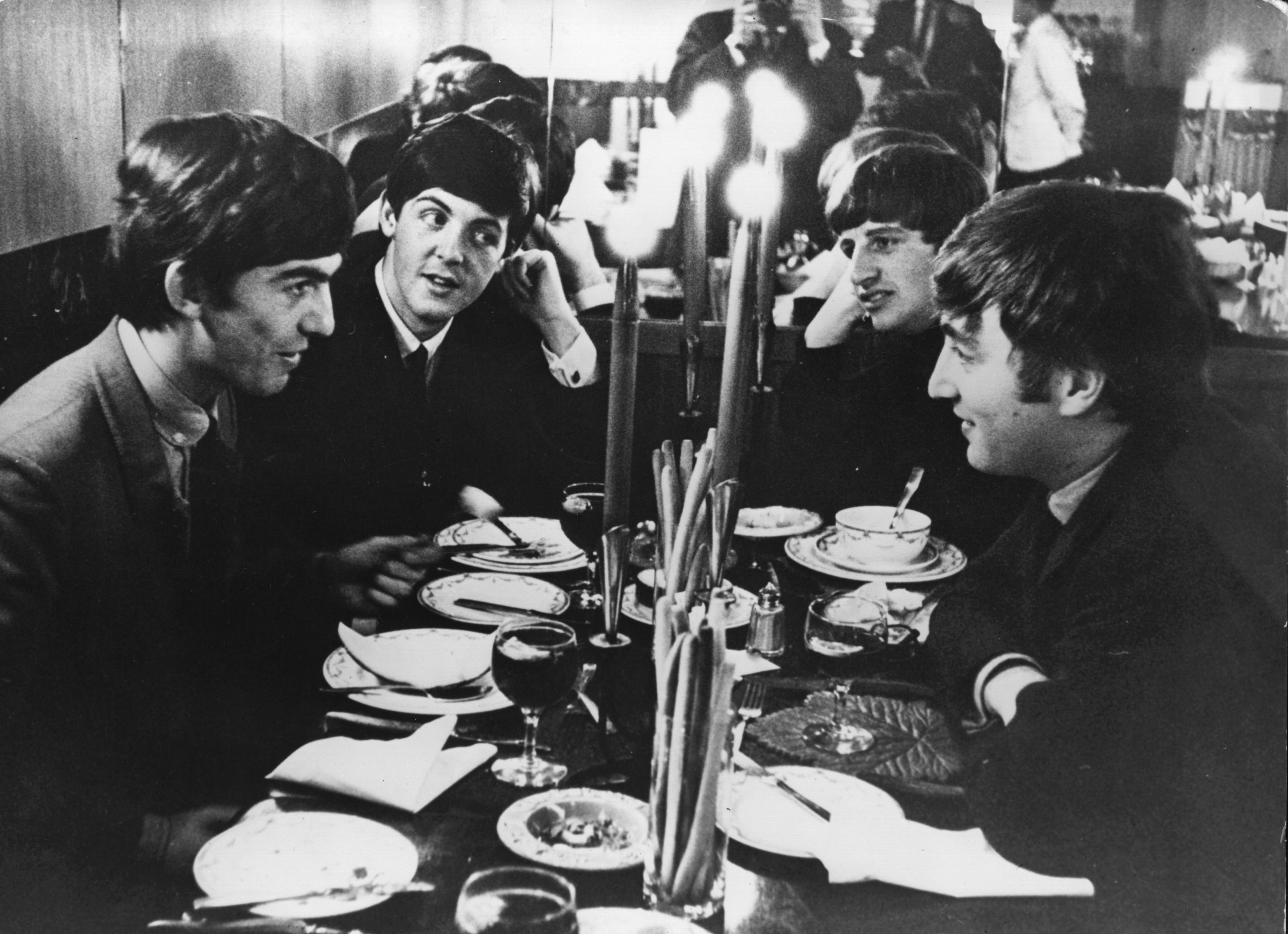 5th October 1963: The Beatles meet for the first time after their holidays by candlelight at the Star Steak House in Shaftsbury Avenue, London. This evening they appear on 'Ready, Steady, Go', the British music television programme. (Photo by Keystone/Getty Images)