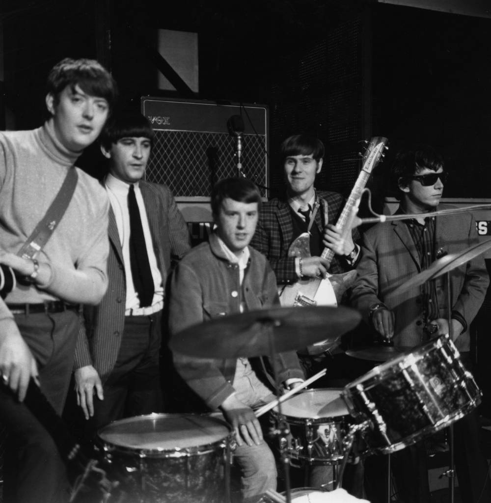 circa 1965: British pop group The Animals, from left to right; Chas Chandler, Alan Price, John Steel, Hilton Valentine and Eric Burdon in a television studio for the recording of a slot for the 'Ready Steady Go' pop programme. (Photo by Express/Express/Getty Images)