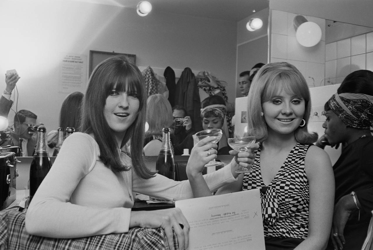 British broadcaster and journalist Cathy McGowan (left) and Scottish singer Lulu at the 'Ready Steady Go!' New Year party, January 1966. (Photo by Express/Hulton Archive/Getty Images)