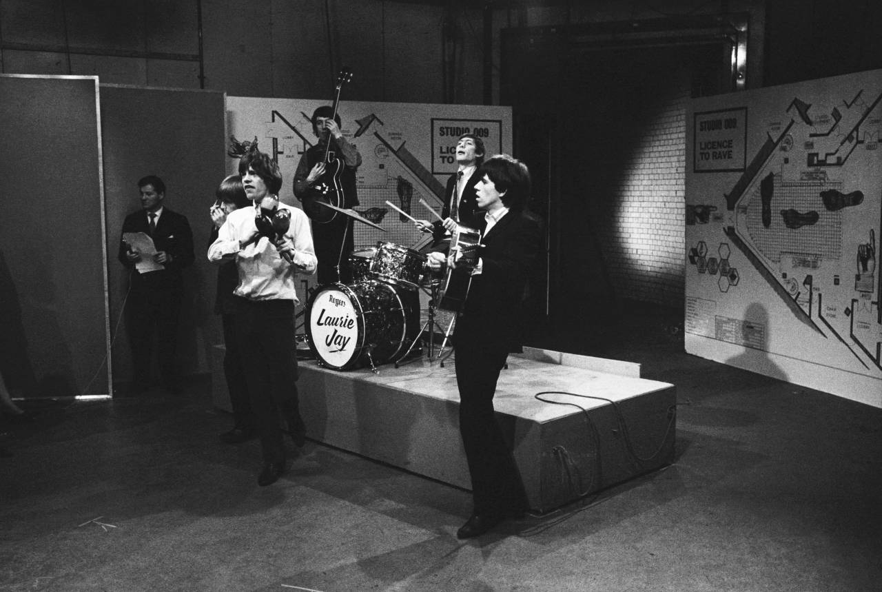 The Rolling Stones appearing on the television show 'Ready Steady Go', 14th February 1964. From left to right, Brian Jones on harmonica, Mick Jagger on maracas, bassist Bill Wyman, drummer Charlie Watts and guitarist Keith Richards. (Photo by Frank Martin/BIPS/Getty Images)