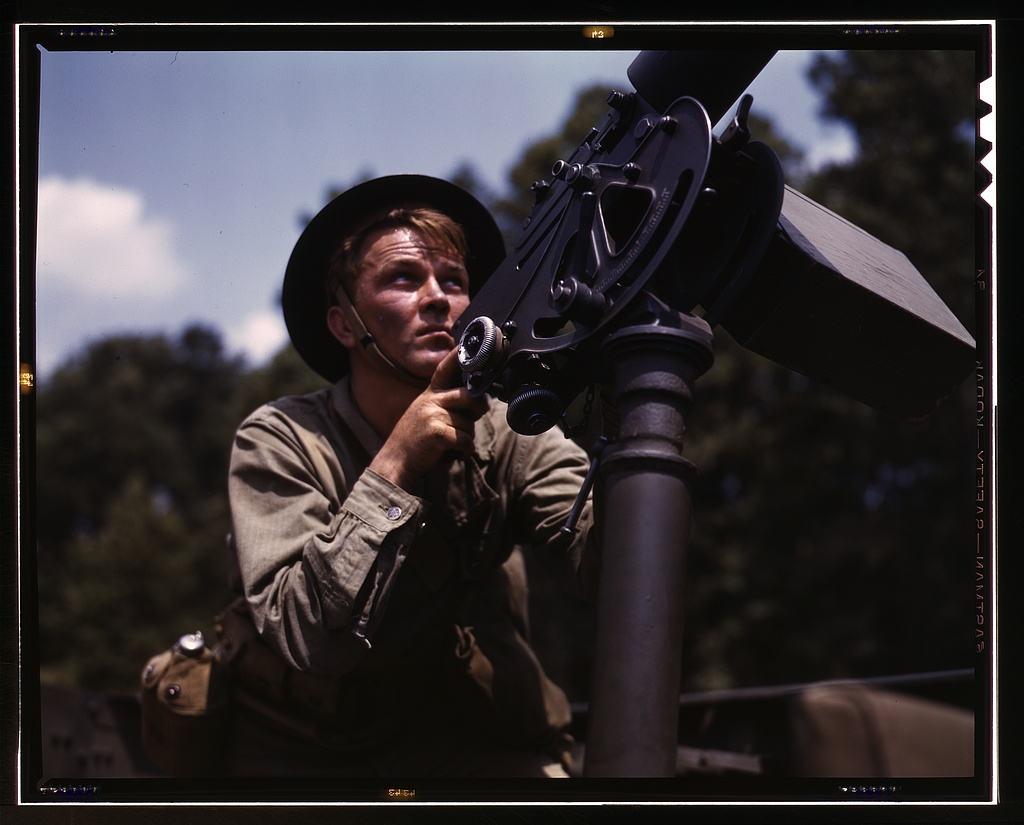 Good man, good gun- a private of the armored forces does some practice shooting with a 30-calibre Browning machine gun, Fort Knox, Ky. The gun is mounted on a pedestal for anti-aircraft work