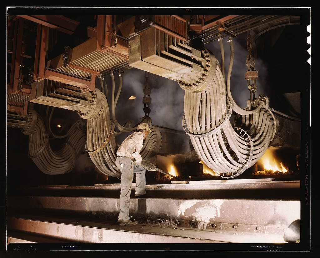 Large electric phosphate smelting furnace used in the making of elemental phosphorus in a TVA chemical plant in the Muscle Shoals area, Alabama