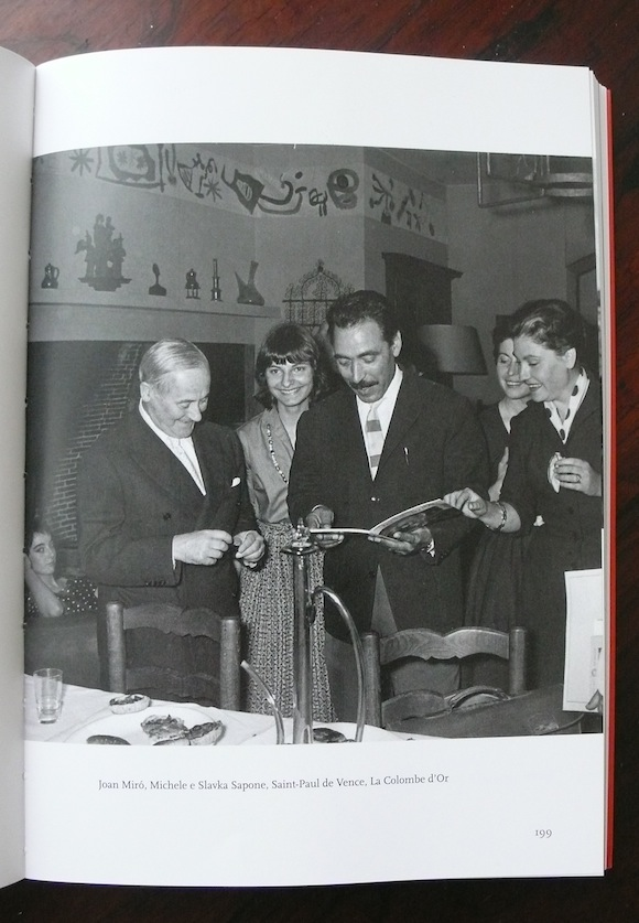 With Joan Miró (left), Slavka and others at the hotel La Colombe d'Or in Saint-Paul de Vence, early 60s. Note Miro's wall decorations in background