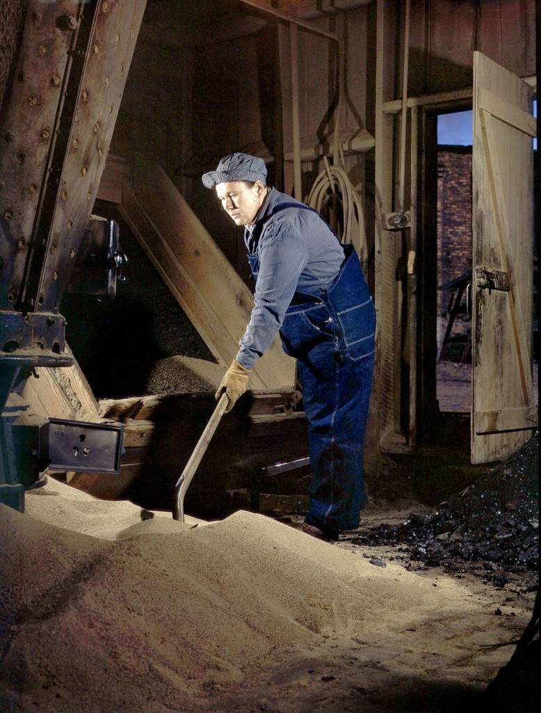Mrs. Thelma Cuvage sifts and cleans sand for use in locomotives.