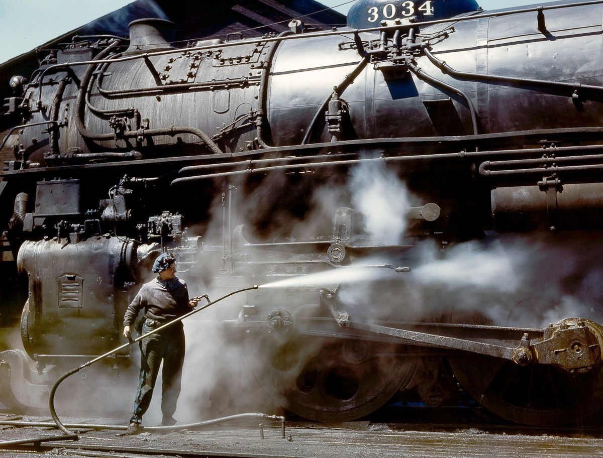 Mrs. Viola Sievers sprays an H-class locomotive with steam.