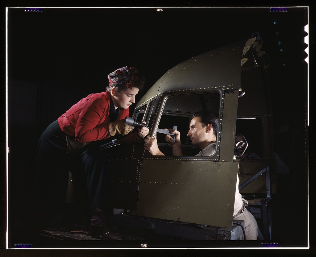 Riveting team working on the cockpit shell of a B-25 [i.e. C-47] bomber at the plant of North American Aviation, Inc., Inglewood [i.e. Douglas Aircraft Company, Long Beach], Calif.