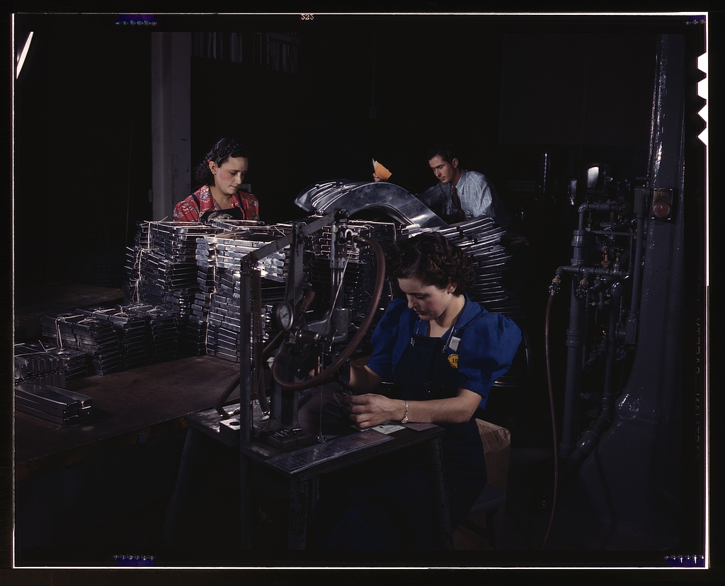 Sheet metal parts are numbered with this pneumatic numbering machine in North American's sheet metal department, N[orth] A[merican] Aviation, Inc., Inglewood, Calif.