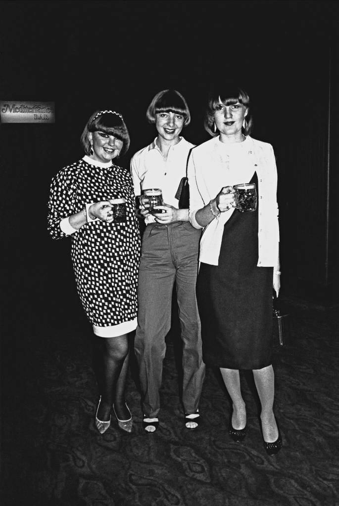 Three young girls posing, holding pints of beer, Ska, 2 Tone fans, UK 1980
