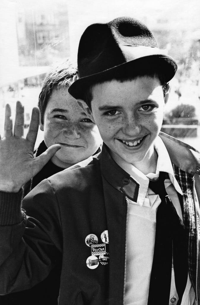 Two young Ska, 2Tone, fans, waving, Coventry, UK 1980