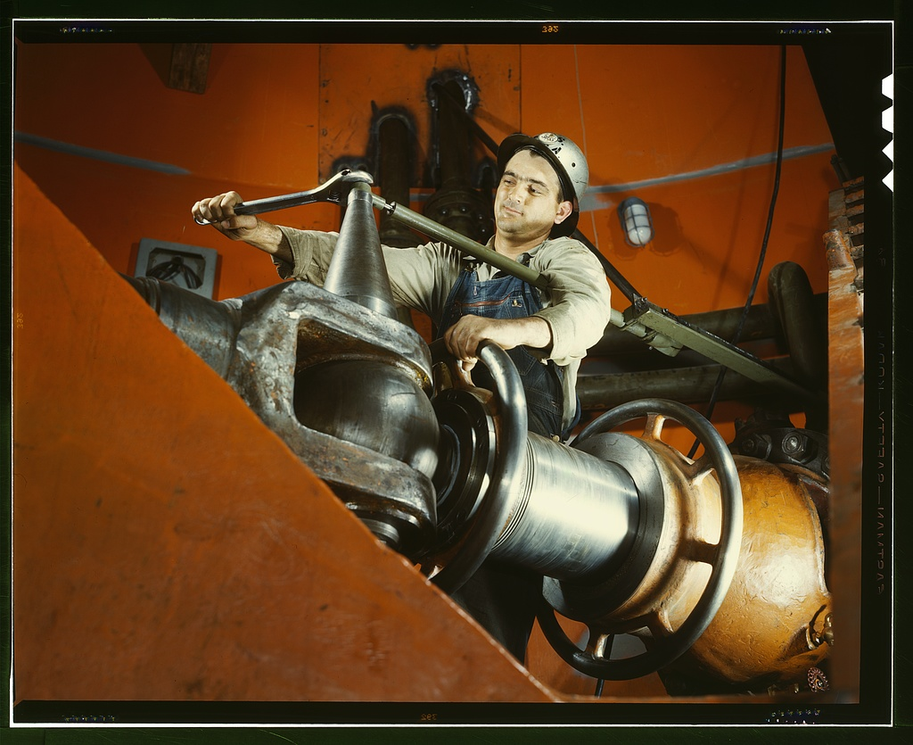 Tightening a nut on a guide vane operating seromotor in TVA's hydroelectric plant, Watts Bar Dam, Tennessee.