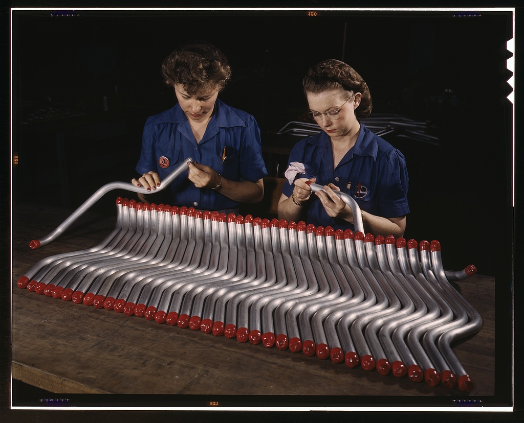 Two women workers are shown capping and inspecting tubing which goes into the manufacture of the %22Vengeance%22 (A-31) dive bomber made at Vultee's Nashville division, Tennessee.