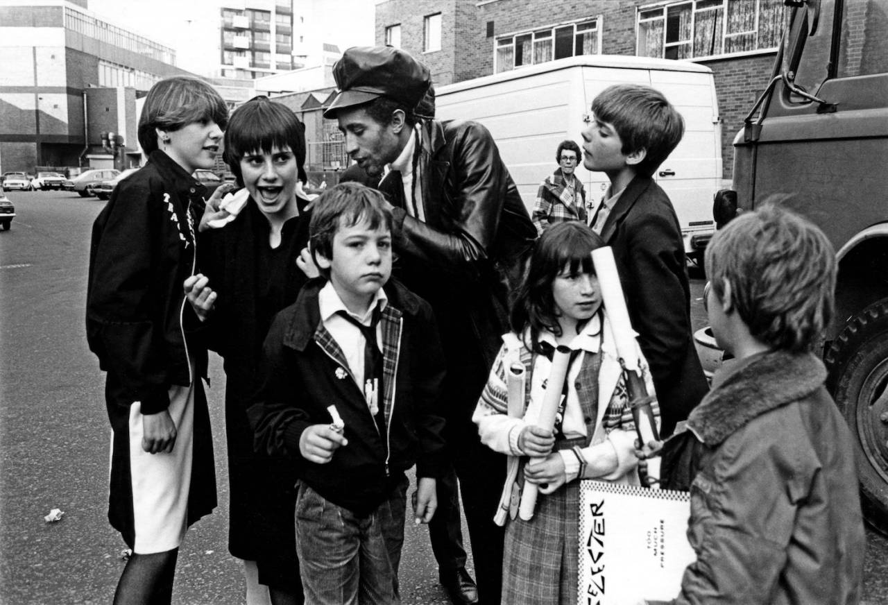 Charlie A. of The Selecter signing autographs for young Ska, 2 Tone fans, UK 1980
