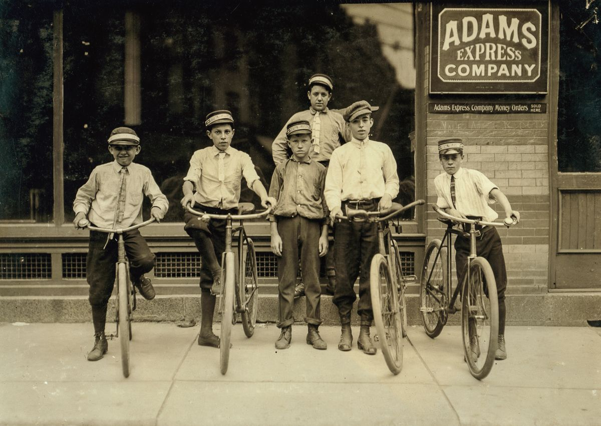 "June 1911 ""A typical group of Postal Messengers in Norfolk, Va. Smallest on left end, Wilmore Johnson, been there one year. Works days only. The Postal boys are not nearly so young, in Norfolk and also in other Virginia cities, as are the Western Union boys."""