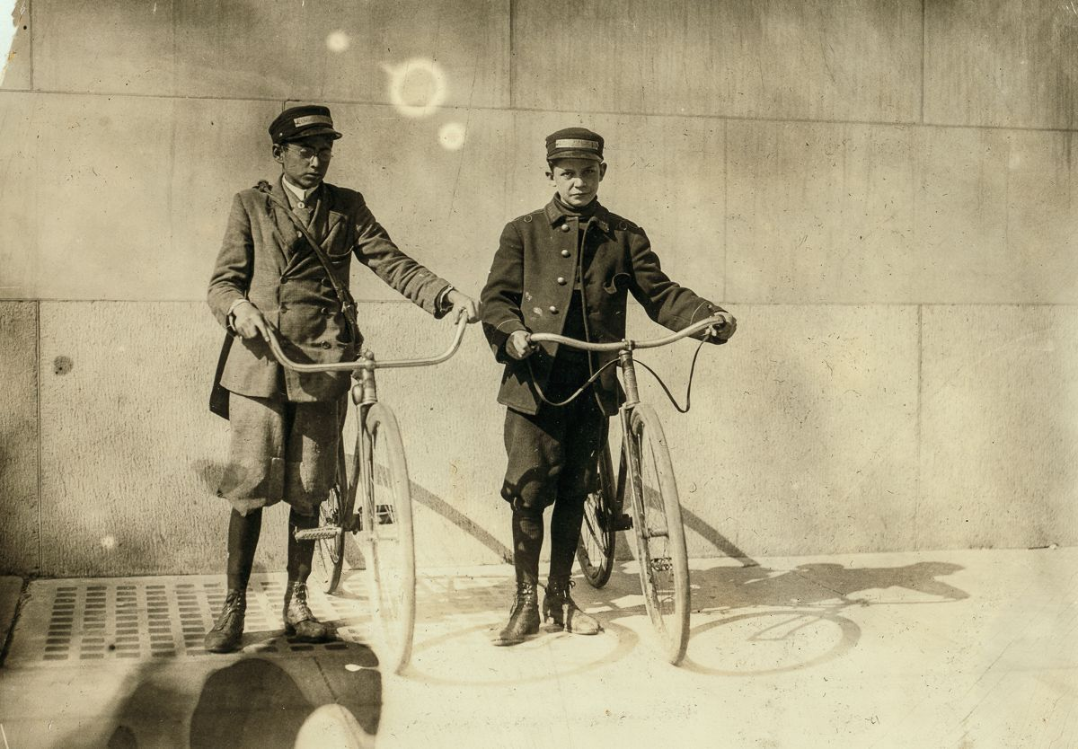 """April 1912 """"Earle Griffith and Eddie Tahoory, working for the Dime Messenger Service. They said they never knew when they were going to get home at night. Usually work one or more nights a week, and have worked until after midnight. They said last Christmas their office had a 9 yr. old boy running errands for them, and that he made a great deal of money from tips. They make about $7 a week and more, sometimes. Said """"'The office is not allowed to send us into the red light district but we go when a call sends us. Not very often.'"""""""