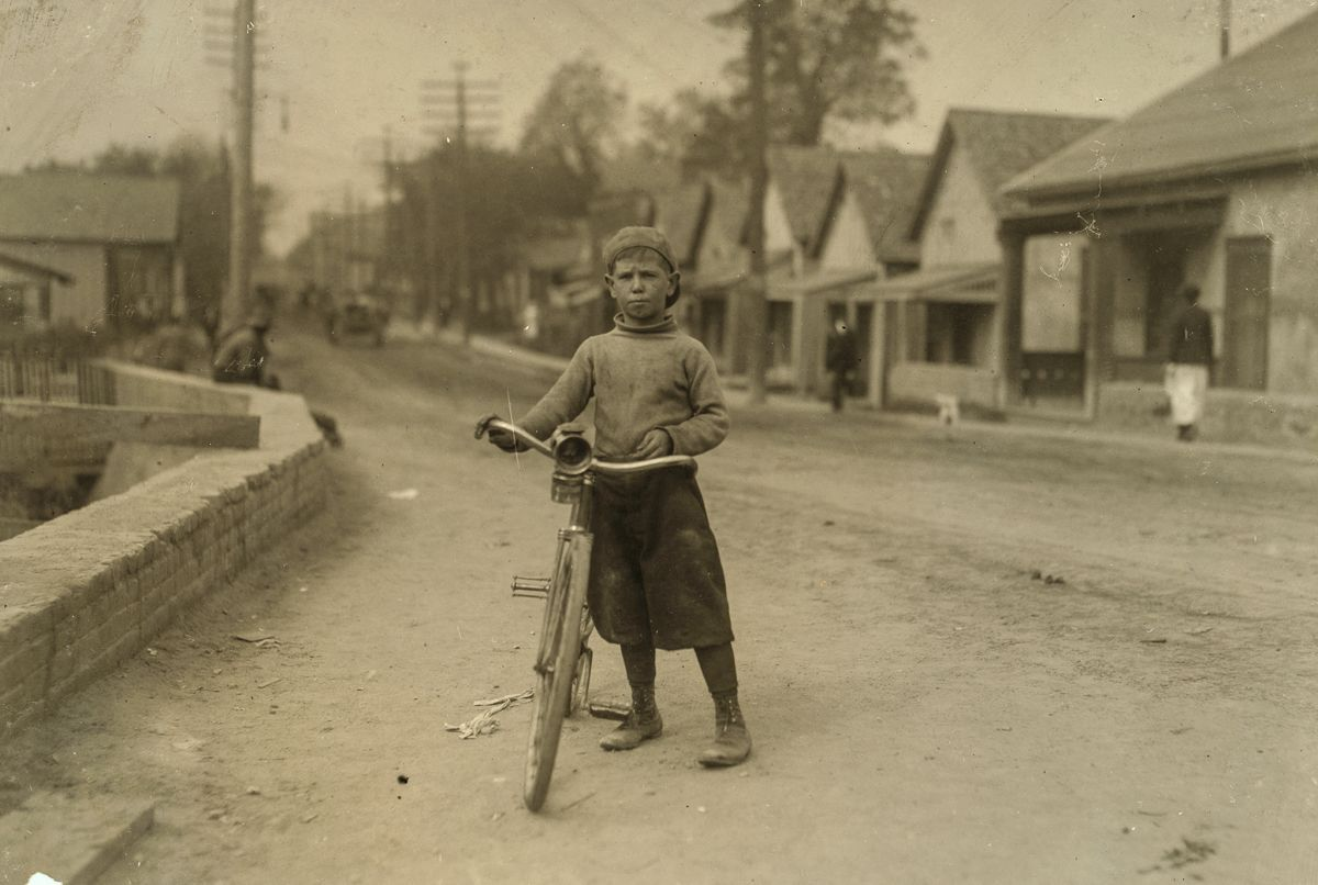 "November 1913 ""Isaac Boyett, 'I'm de whole show.' The twelve year old proprietor, manager and messenger of the Club Messenger Service, Waco, Texas. The photo shows him in the heart of the Red Light District where he was delivering messages as he does several times a day. Said he knows the houses and some of the inmates. Has been doing this for one year, working until 9:30 P.M. on Saturdays. Not so late on other nights. Makes from six to ten dollars a week."""