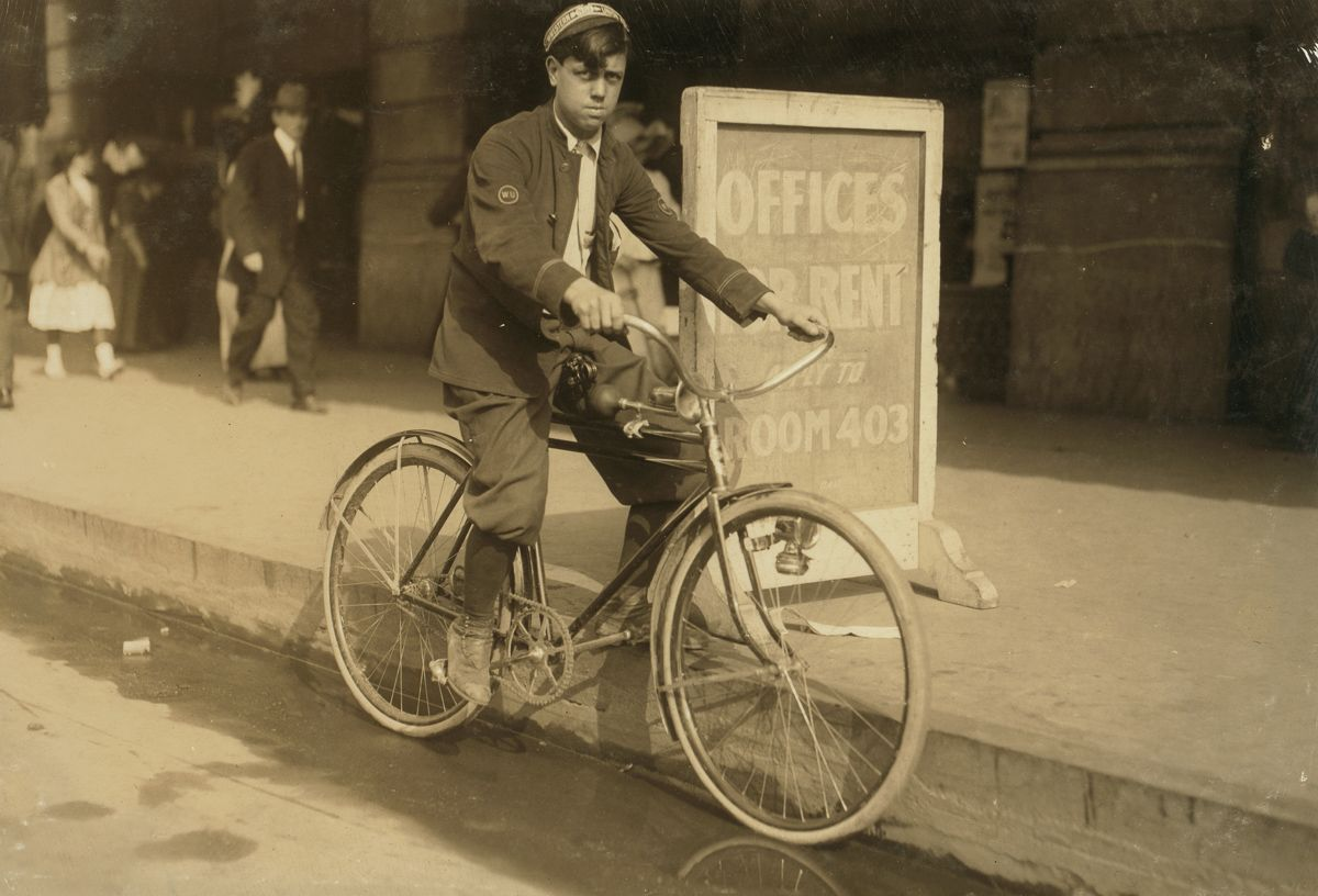 "November 1913 ""A typical messenger boy in New Orleans. The telegraph companies are trying to obey the law, and few violations occur."""