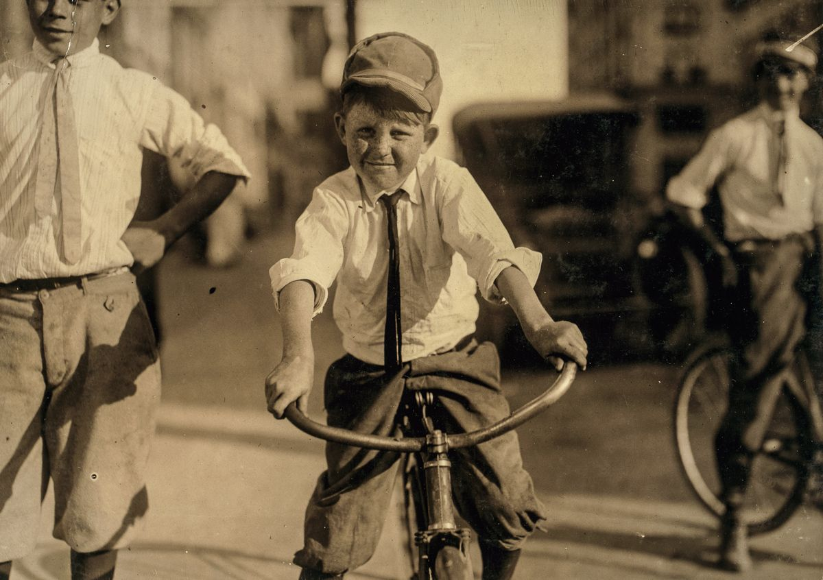 "October 1913 ""Eleven year old Western Union messenger #51. J.T. Marshall. Been day boy here for five months. Goes to Red Light district some and knows some of the girls. Location: Houston, Texas."""