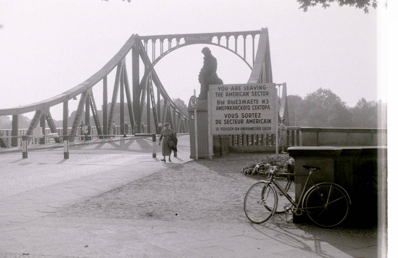 Glienicke Bridge Berlin 10th September 1959. The Glienicke Bridge crosses the Havel River connecting the Wannsee district of Berlin with the Brandenburg capital Potsdam. During the Cold War the bridge was used several times for the exchange of captured spies and thus became known as the Bridge of Spies. During the early years of the Cold War, the bridge was mainly used by the Allies as a link between their Berlin sections and the military liaison missions in Potsdam. German residents of the two cities more frequently used the S-Bahn suburban rail to travel between Berlin and Potsdam. On 27 May 1952, East German authorities closed the bridge to citizens of West Berlin and West Germany. The bridge was closed to East German citizens after the construction of the Berlin Wall in August 1961. Only allied personnel were allowed to access the bridge at any time.
