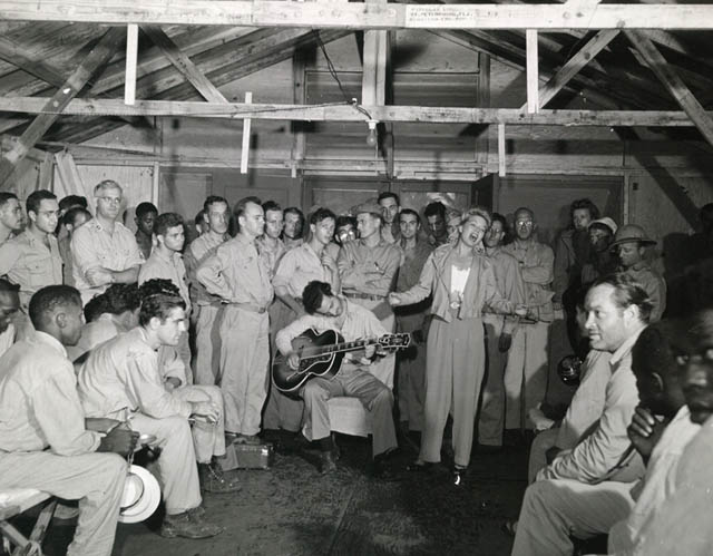Guitarist Tony Romano accompanies Frances Langford in an impromptu performance, 1944.