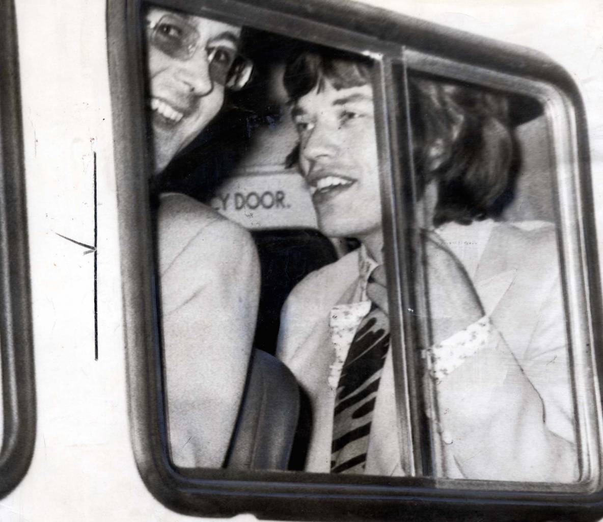 Mick Jagger - Pop Star Mick Jagger In The Police Van On The Way To Lewes Prison. Mick Jagger Lead Singer With The Rolling Stones Pop Group Went To Court In A Blue Continental Bentley Yesterday. Three And Half Hours Later After Being Found Guilty On A Drugs Charge - He Was Driven Off To Lewes Prison In An Austere Grey Police Van.