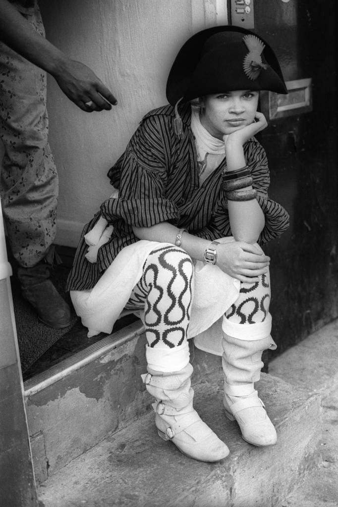 Mandatory Credit: Photo by Ted Polhemus/PYMCA/REX/Shutterstock (3489125a) Girl with Vivienne Westwood's Pirate look sits outside 'World's End' shop on Kings Road, Chelsea London 1980 STOCK