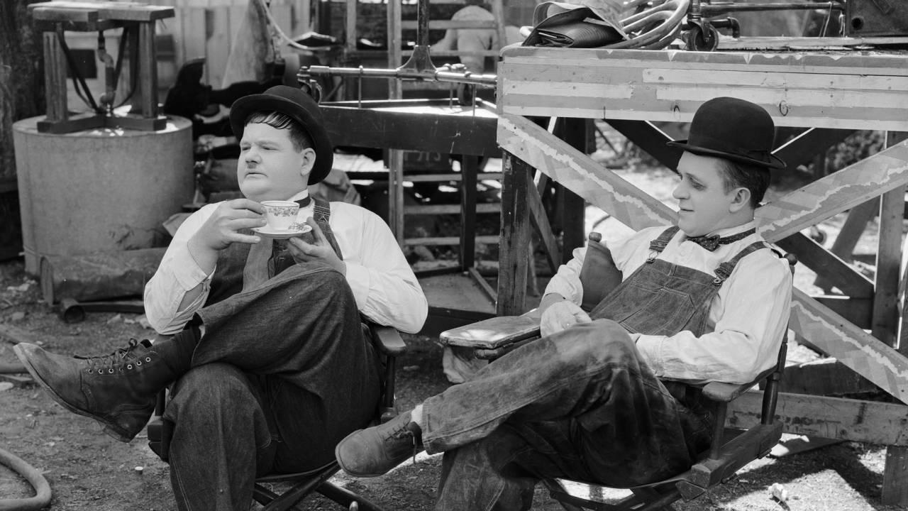 "1932- Stan Laurel, with a blackened eye, and Oliver Hardy during a break in the filming of ""Towed in a Hole,"" directed by George Marshall."