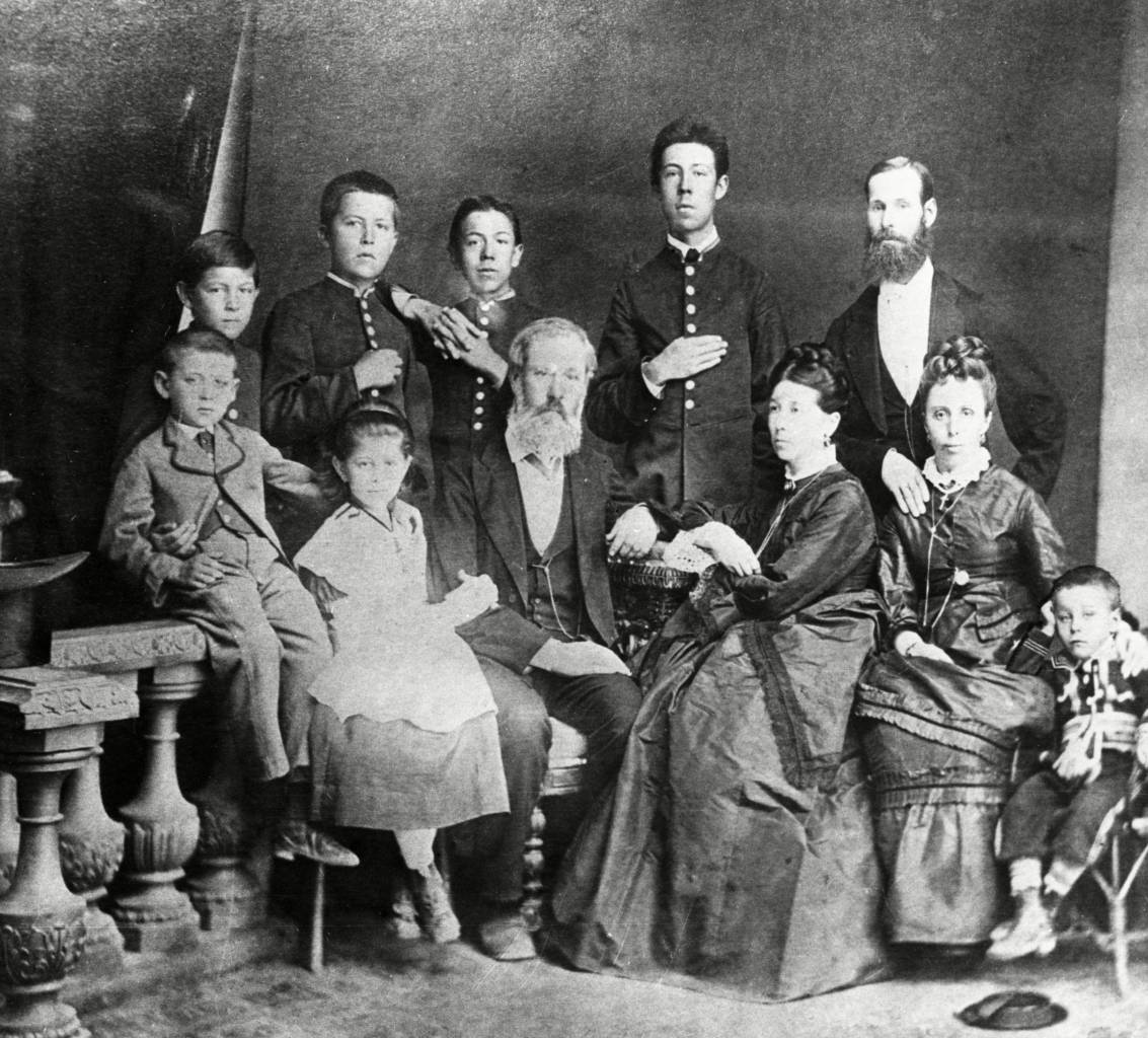 Chekhov family portrait, in the center, sitting, are the parents,pavel and yevgenia chekhov, on the left are Mikhail and maria, on the right is aunt lyudmila with her son georgy, standing (from left) are ivan, anton, nikolai, Alexander, and uncle mitrofan, 1874 or 1875. VARIOUS