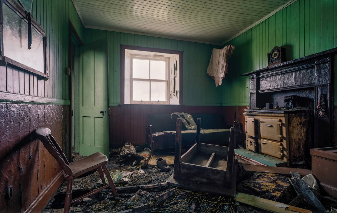 """GREEN ROOM A sheep lies on top of 12"""" vinyl records. One year after this photo was taken, the roof collpased, burying everything you see under timbers and roof slates."""