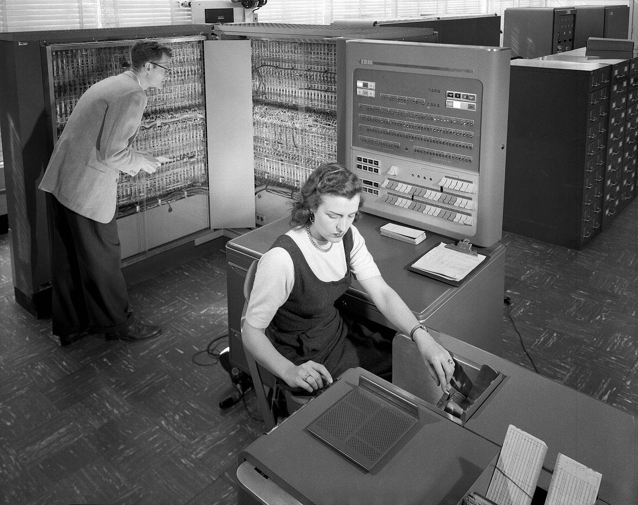 NACA researchers using an IBM type 704 electronic data processing machine in 1957
