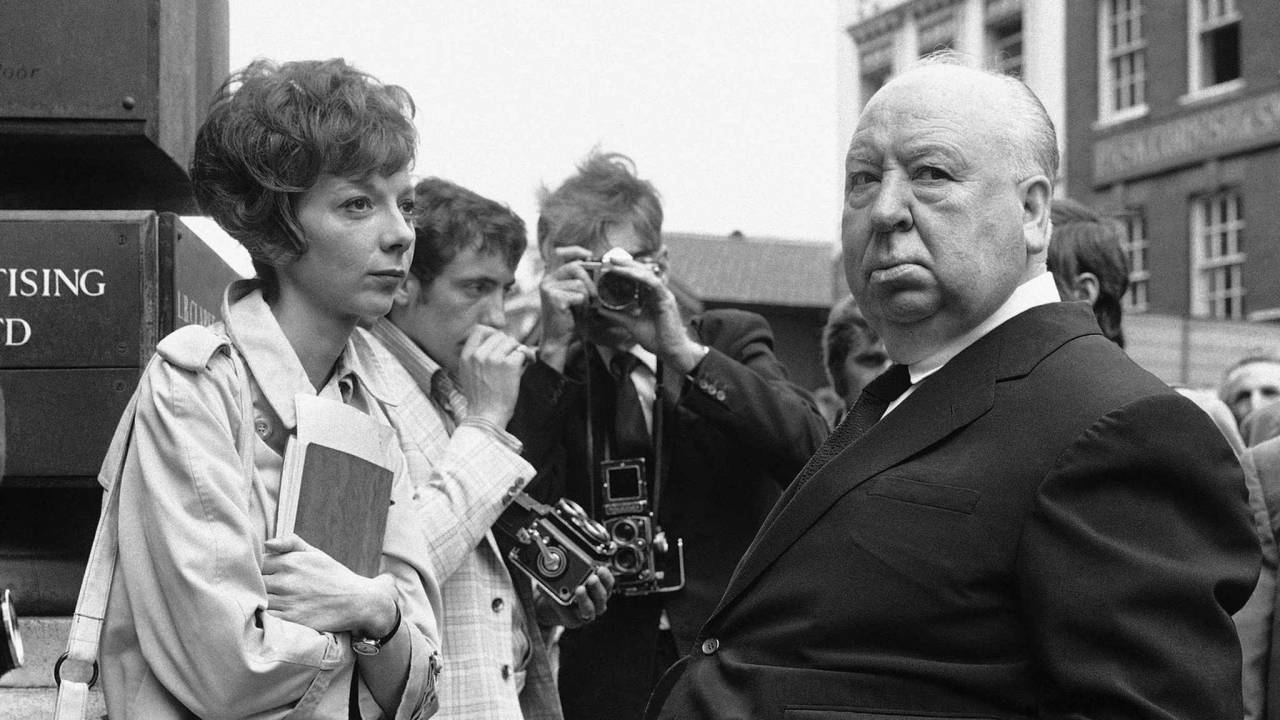 July 26, 1971, photo, Alfred Hitchcock, right, discusses filming with actress Anna Massey, one of the stars of Frenzy, in Covent Garden Market in London.