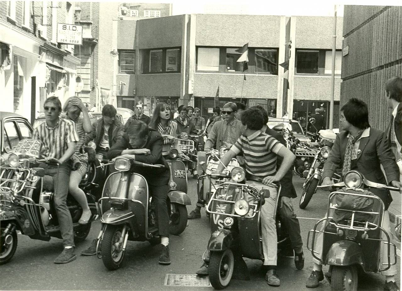 Mods on scooters in the Carnaby Street area of London filming 'Steppin' Out', summer 1979