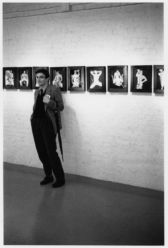 """""""This is an interesting image, showing the now-famous curator years before Sensation at a show of John Maybury's queer paintings at avant garde gallery B2, which had just become the first UK space to show Robert Mapplethorpe."""" Norman Rosenthal, Wapping, 1980. © David Gwinnutt"""
