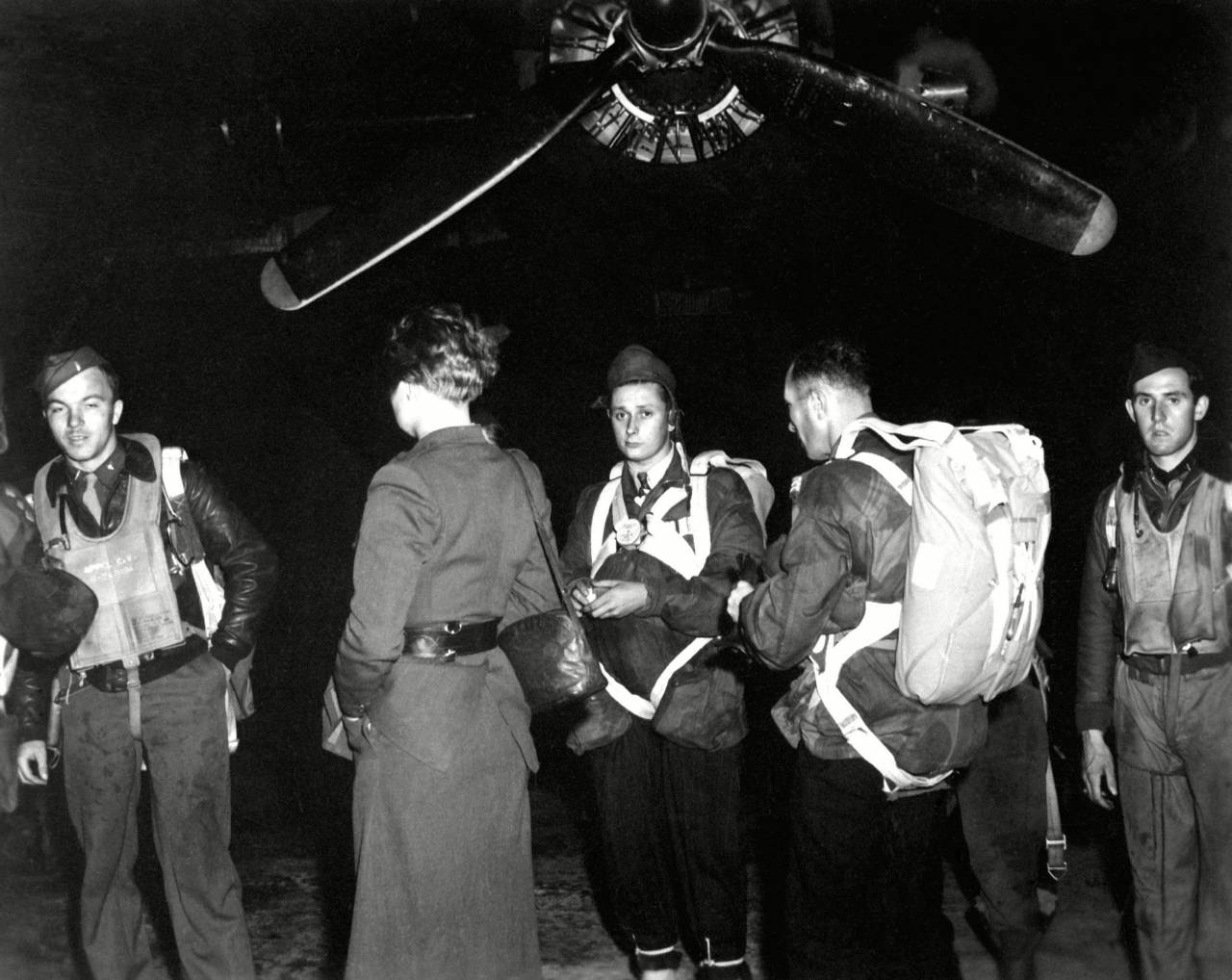 A Jedburgh team by a B-24 from which they would parachute into occupied France. They were among 93 Jedburgh teams who linked French guerrillas and the Allied command during World War 2. Area T. Harrington Airdrome, England, ca. 1944.