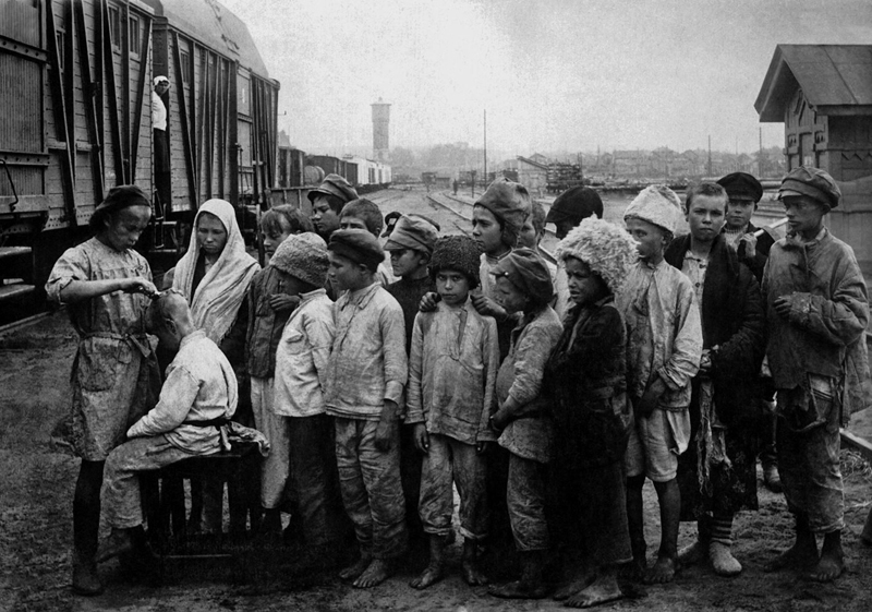 Moving orphans from famine areas. Date: early 1920