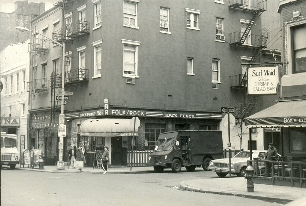 The Back Fence music bar on Bleecker Street, Greenwich Village, New York, November 1983.   Next door is Kenny's Castaways, a club where many bands have played over the last 45 years including the New York Dolls, Blondie, Kiss and Patti Smith. It was where Joey and DeeDee Ramone first met, and in 1973 Bruce Springsteen played here, his New York City debut with the E Street Band.   Sadly Kenny's Castaways will be closing after 45 years on 30 September 2012.   Across the street is the Surf Maid, which hosted live jazz music. This is now the Red Lion, a live music bar.   The Back Fence 155 Bleecker Street (at Thompson St.) New York NY 10012   Kenny's Castaways 157 Bleecker Street New York NY 10012   Surf Maid 151 Bleecker Street (between Laguardia Pl & Thompson St) New York NY 10012