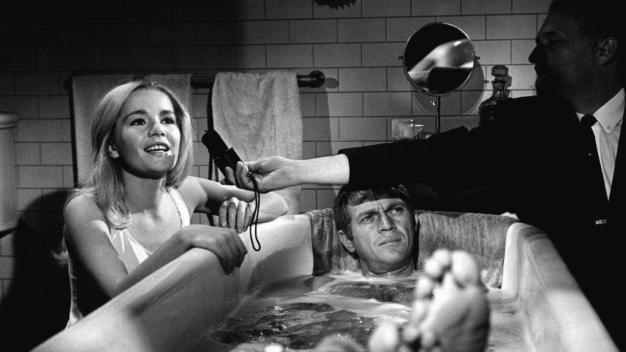 While cameraman Phil Lathrop is taking a light meter readingTuesday Weld and Steve McQueen on the set of The Cincinnati Kid, directed by Norman Jewison in 1965.