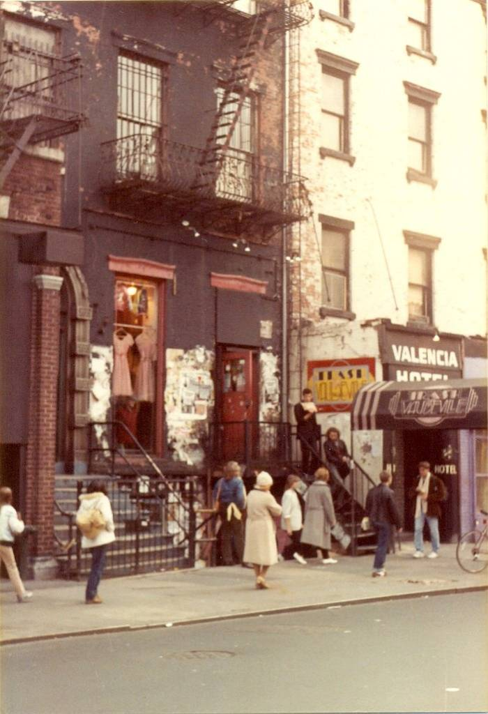 This is Saint Marks Place as it looked in November 1982. The shop with dresses hanging up in the window is Trash and Vaudeville, which is famous for supplying stars like The Ramones and Debbie Harry of Blondie with clothing during the golden age of punk rock in the 1970s and 80s. The store opened in 1975 and is still in its original location.   Next door is the Valencia Hotel which was home to beat writer William S. Burroughs in the early 1970s. In the 1980s punk rock singer-songwriter GG Allin lived there. The hotel is now the St. Mark's Hotel.   Trash and Vaudeville 4 Saint Marks Place New York NY 10003