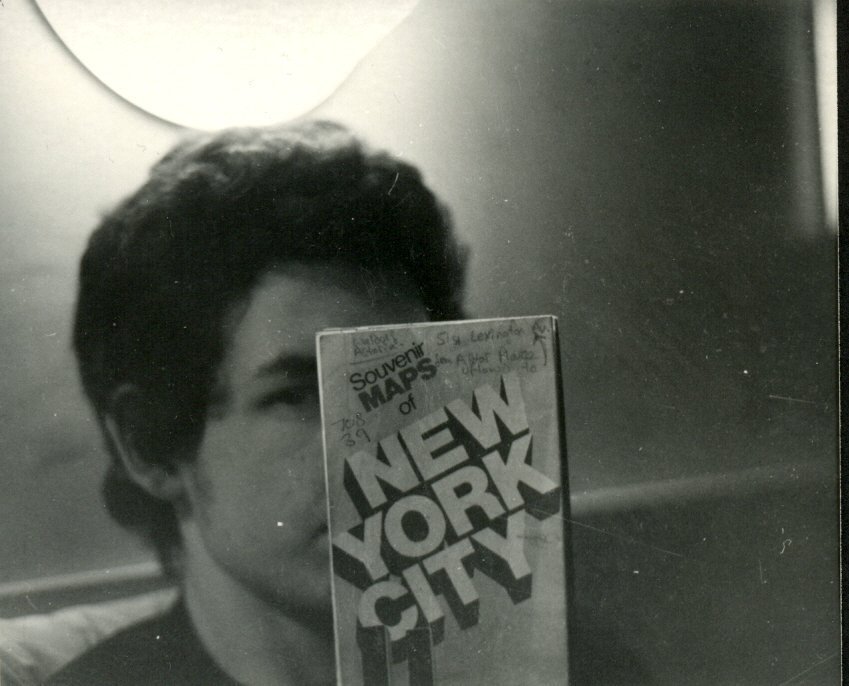 My friend Paul at the Hotel Earle, Room 708, New York City, November 1983.   The Hotel Earle was built in 1902 and Ernest Hemingway stayed at the hotel for a few weeks in 1914. In the 1950s Dylan Thomas and his wife Caitlin stayed at the Earle.   By the 1960s and early 1970s it had become a seedy apartment hotel and musicians, including Bob Dylan, Joni Mitchell and Joan Baez, made it their temporary home.   John Sebastian, Bill Cosby, Barbra Streisand, the B-52's, Maynard Ferguson, Bo Diddley and the Ramones have all stayed at the Earle.   The hotel changed its name from the Hotel Earle to the Washington Square Hotel in 1986.   Hotel Earle 103 Waverly Place New York City NY 10011