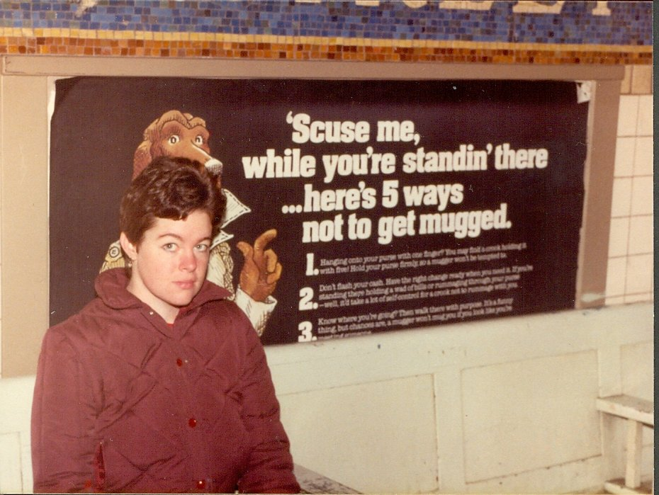 "This is a photograph of my friend Kim in a New York City subway station, in November 1982. It was risky taking photographs in the subway back then because there was a good chance you would get mugged and have your camera stolen.   In the background is a poster with the words: 'Scuse me, while you're standin' there… here's 5 ways not to get mugged. Only three examples are left on the poster, the other two have been ripped off by vandals!   In the 1983 edition of the New York Blue Guide book there was some advice on travelling by subway:   ""SUBWAY SAFETY: The New York subway system has a reputation for crime and filth which is not undeserved. Stations have been vandalised, cars sprayed with graffiti, platforms are smelly and filthy in many stations. In 1981 there were 15,812 felonies in the transit system including 13 murders, but it is also true that more than three million travellers ride the system daily and survive. Use common sense; be alert to your surroundings; stay with other people; don't go down empty stairwells or ride in empty cars; don't lean over the edge of the platform; if in doubt stay near the conductor who has a telephone, as does the attendant at the toll booth."""