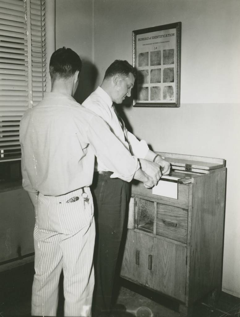 Fingerprinting in the Bertillon Office, c. 1960. Photo: collection of Eastern State Penitentiary Historic Site, gift of the Scheerer Family.