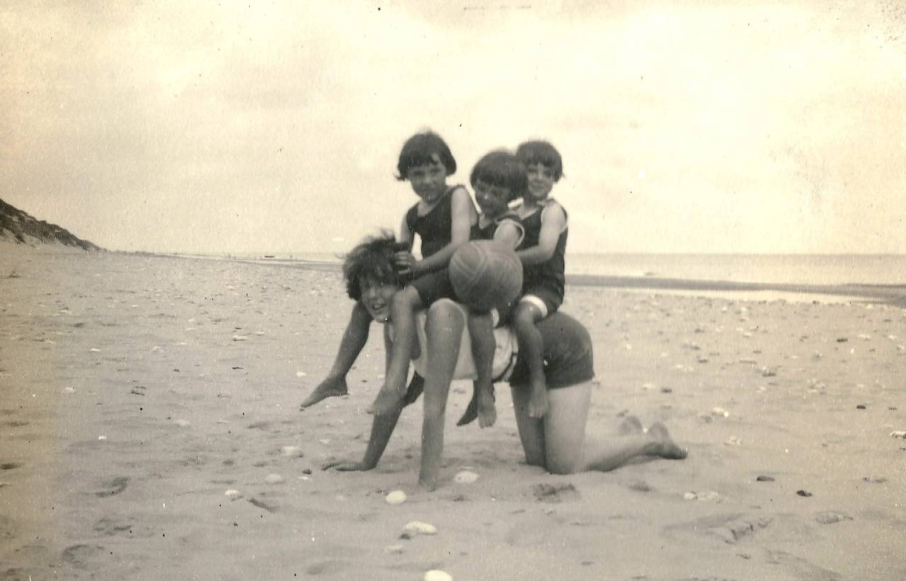 The beach at Waxham, Norfolk, in August 1927. The woman's relationship to the girls is unclear--perhaps their mother or an aunt?